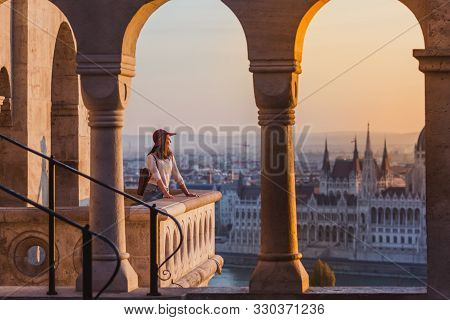 A Happy Young Woman Enjoying Her Trip To The Castle Of Budapest In Hungary On The View Point From Fi