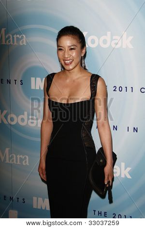 BEVERLY HILLS, CA - JUNE 16: Michelle Kwan at the 2011 Women In Film Crystal + Lucy Awards at the Beverly Hilton Hotel in Beverly Hills, California on June 16, 2011.