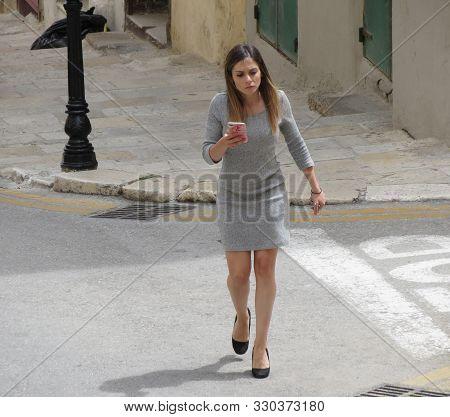 Valletta, Malta - Circa May 2019: Unidentified Girl In Grey Short Dress And Heels