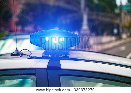 Close-up Of Flashing Lights On A Police Car.