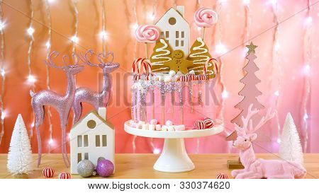 Candy Land Christmas Cake In Pink And Gold Party Table Setting.