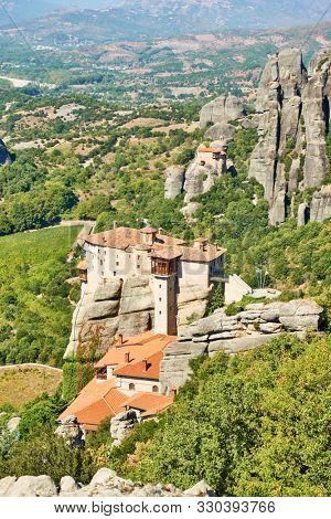 Monasteries of Rousanou and of Agios Nikolaos Anapafsas on the cliffs in Meteora, Greece - Greek landscape