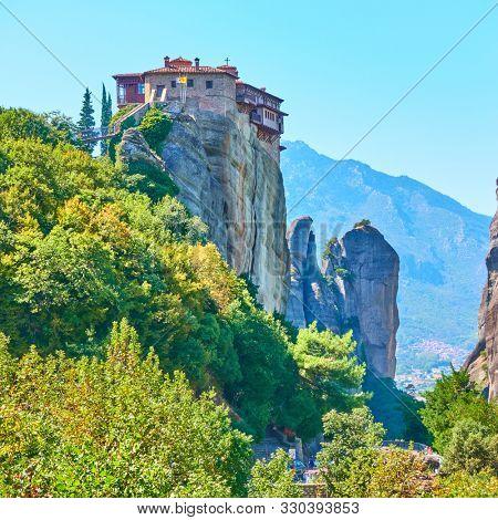 The Monastery of Rousanou on the cliff in Meteora, Greece - Greek landscape