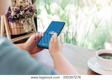 Chiang Mai, Thailand - Oct.18,2019: Woman Holding Xiaomi Mi Mix 3 With Onedrive On Screen. Microsoft