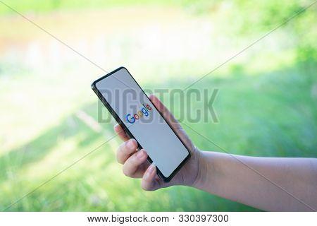 Chiang Mai, Thailand - Oct.18,2019: Woman Holding Xiaomi Mi Mix 3 With Google App On Screen. Google