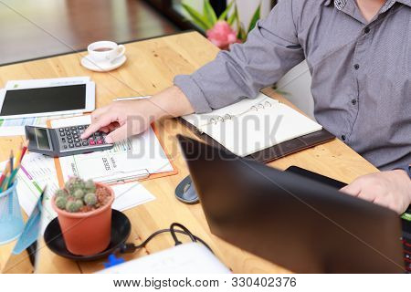 Small And Medium Enterprise Business Concept Of ,businessman Using Calculator To Calculate Assets Ch