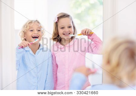Child Brushing Teeth. Kids With Toothpaste And Brush. Dental And Oral Hygiene, Care. Healthy Daily R