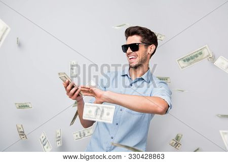 Photo Of Cheerful Excited Ecstatic Overjoyed Man Throwing Money Away Showing His Wealthiness Wearing