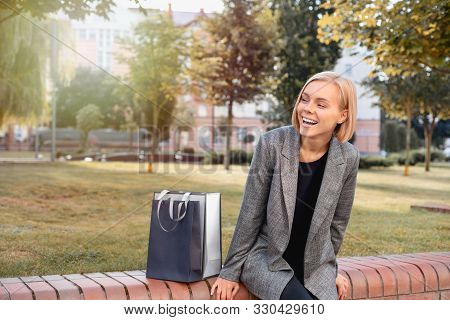 Beautiful Woman In Town With Shopping Bags. Happy Lifestyle Concept