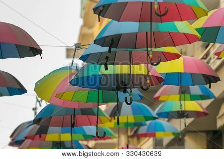 Road With Umbrellas At Trikala In Greece.