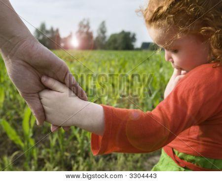 Little Gilr Holding Hand