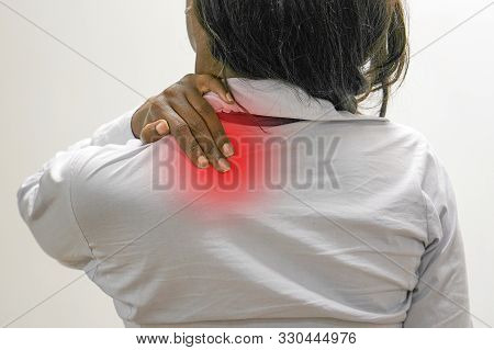 Pain In The Neck Of A African Woman From Fatigue. The Concept Of Body And Health.