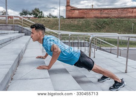 Athletic Man, Push Ups From Concrete Steps, Summer Afternoon Training In The City, Active Lifestyle,