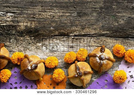 Mexican Celebration, Bread Of Death. Mexican Parties Dead Bread And Marigold Flowers On Wooden Rusti
