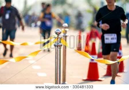 Luxury Stainless Barricade With Yellow Rope Ribbon On The Road In Marathon Event At The Finish Point