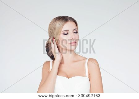 Perfect Model Woman With Updo Hairstyle On White Background
