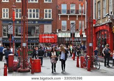 London, Uk - July 6, 2016: People Visit Chinatown District Of London, Uk. There Is A Minority Of 433