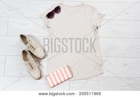 T-shirt Mock Up, Tshirt Top View, White Closeup T Shirt Mock Up Flat Lay On White Wooden Background.