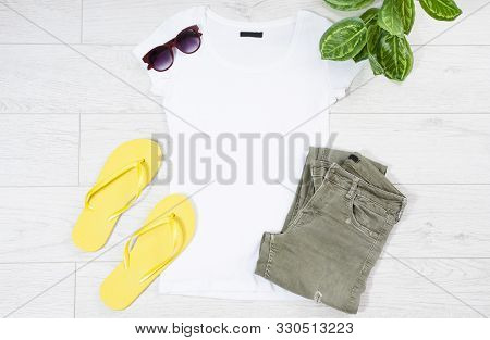 Tshirt Mock Up, T-shirt Top View, Close Up T Shirt Mock Up Flat Lay On Wooden Background. Top View A