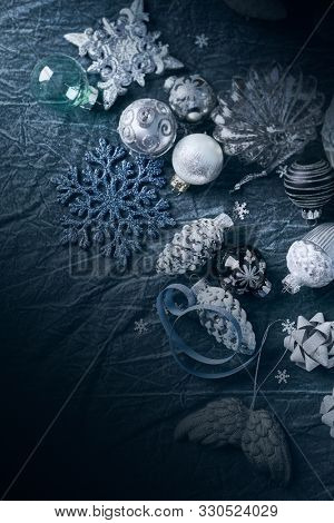 Silver and white Christmas decorations on indigo blue background. Copy space. Christmas background