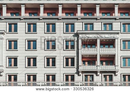 A Grayish Facade Of A Modern Multi-storey Building Made In A Typical Modern Russian Architecture Sty
