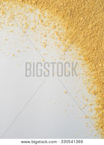 Nutritional Yeast On White Background. Nutritional Inactive Yeast Top View. Copy Space. Nutritional