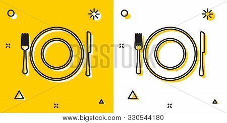 Black Plate, Fork And Knife Icon Isolated On Yellow And White Background. Cutlery Symbol. Restaurant