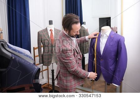 Tailor measuring mannequin for custom made suit in atelier