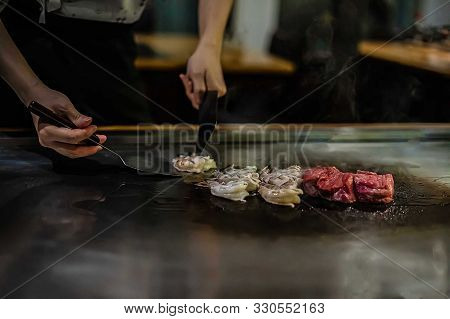 Teppan Show In A Japanese Restaurant, Cooking Directly In Front Of The Client, Fish, Rice, Meat, Veg