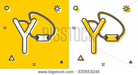 Black Slingshot Icon Isolated On Yellow And White Background. Random Dynamic Shapes. Vector Illustra