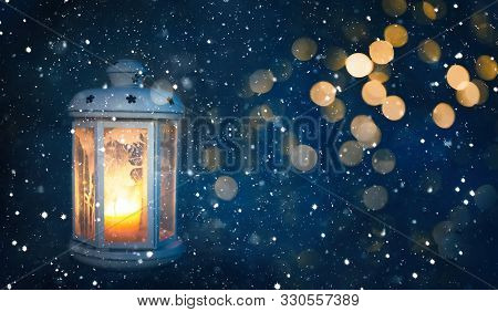 Beautiful Winter Christmas Background With Copy Space. Lighted Christmas Lantern On Dark Background