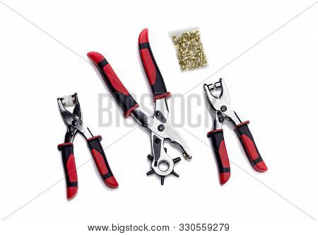 Sewing Equipment. The Eyelet Pliers Set For Punching Holes Or Attaching Press Studs And Eyelets On A