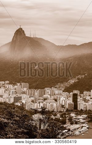 View Of Sepia Toned Buildings In The  City Of  Rio De Janeiro With Favelas In The Hills With Misty S