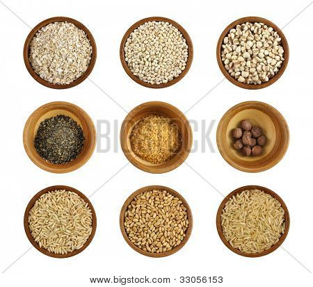 Assortment of wholesome ingredient in a wooden bowl - Oats, Barley, Job's tears (Chinese pearl barley), Crushed Black sesame, Wheatgerm, Lotus seeds, Glutinous rice, Wheat Berries, Half-polished rice