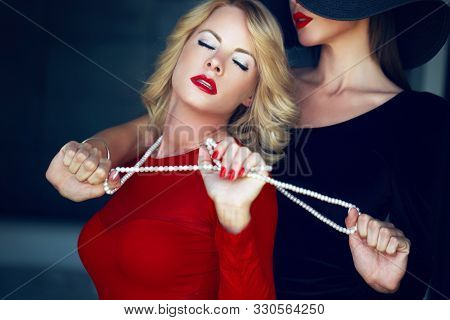 Sensual Woman In Red With Lesbian Lover, Lust And Pearls