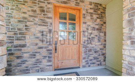 Panorama Frame Wooden Front Door Of Modern House With Stone Walls
