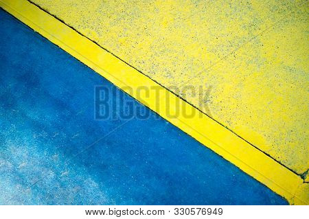 Background, Texture - Concrete Wall, Blue And Yellow. Rough Surface.