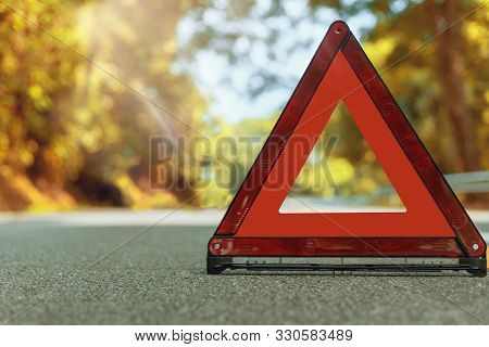 Autumn Road Red Triangle, Red Emergency Stop Sign, Red Emergency Symbol And Black Car Stop And Park