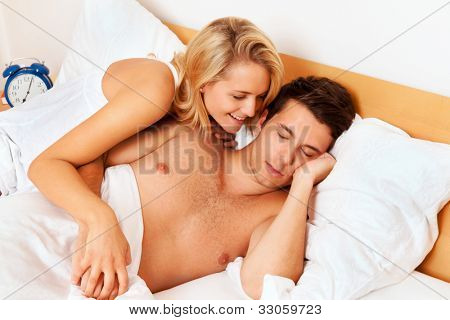 couple has fun in bed. laughter, joy and eroticism in the bedroom poster