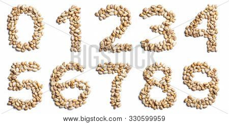 Arabic Numerals From An Unpeeled  Pistachios On A White Isolated Background.  Unpeeled  Pistachios P