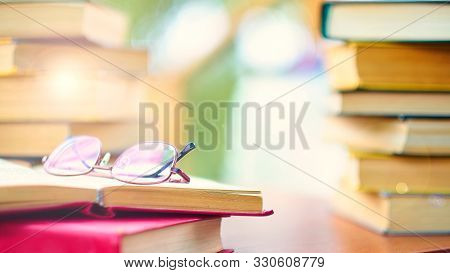 Glasses And Open Book. Best Books Home Library Background. Read Vintage Books In A Row. College Libr