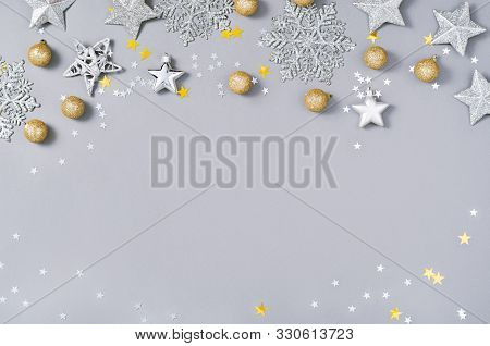 Christmas And New Year Holiday Background. Xmas Greeting Card. Christmas Accessories On Gray Backgro