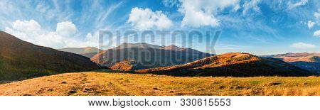 Wonderful Panorama Of Mountain Ridge In Autumn. Gorgeous Landscape With Rolling  Hills And Meadows I