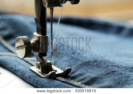 Sewing Machine And Item Of Clothing So Close, Blue Jeans