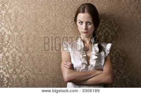 Young Woman Leaning Against A Wall