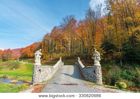 Wonderful Autumn Scenery In The Park. Bridge Across The Forest Stream. Trees In Colorful Foliage. Wo