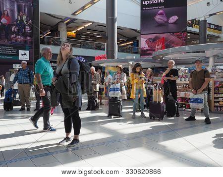 Gatwick, Uk - Circa September 2019: People At London Gatwick Airport