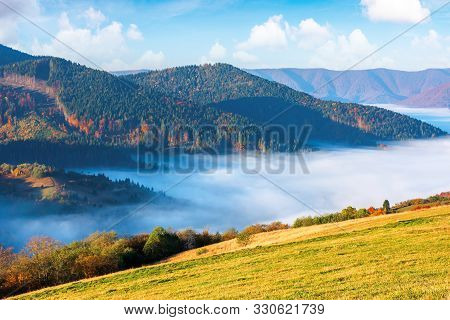 Gorgeous Sunny Morning In Mountains. Picturesque Carpathian Countryside In Autumn. Fog In The Valley