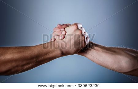 Handshake, Arms. Friendly Handshake, Friends Greeting. Rescue, Helping Hand. Male Hand United In Han