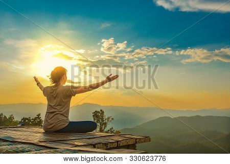Healthy Woman Lifestyle Balanced Practicing Meditate And Zen Energy Yoga Outdoors On The Bridge In M